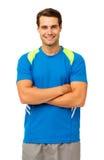Szczęśliwy mężczyzna W Sportswear pozyci rękach Krzyżować obrazy royalty free