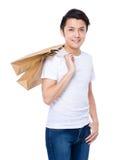 Szczęśliwy mężczyzna z torba na zakupy Obraz Royalty Free
