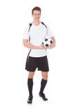 Szczęśliwy męski gracz piłki nożnej Zdjęcia Stock