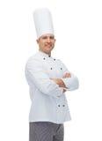 Szczęśliwy męski szefa kuchni kucharz z krzyżować rękami Obraz Royalty Free