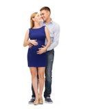 Szczęśliwy młody rodzinny oczekuje dziecko Zdjęcie Stock