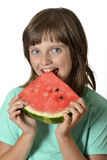 Szczęśliwy małej dziewczynki łasowania melon Zdjęcie Royalty Free