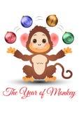 Szczęśliwy mały małpi żonglować z baubles Zdjęcia Stock