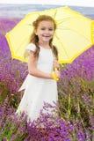 Szczęśliwy mały princess w lawendy polu z Obraz Royalty Free