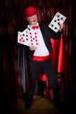 Szczęśliwy magik z kartami Fotografia Stock