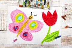 Szczęśliwy motyl i piękny tulipan Obraz Stock