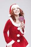 Szczęśliwy Nęcący Kaukaski Czerwony z włosami Santa pomagier z koloru cukierki Zdjęcie Stock