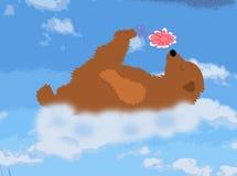 Szczęśliwy niedźwiedź jest chmurą z kwiatem Zdjęcia Royalty Free