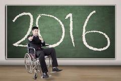 Szczęśliwy niepełnosprawny biznesmen z liczbami 2016 Zdjęcie Stock