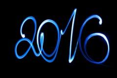 Szczęśliwy 2016 nowego roku latarki wpisowy promień Obrazy Royalty Free