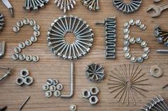 Szczęśliwy nowego roku 2016 skład z śruba gwoździami czmycha i dowels Zdjęcie Royalty Free