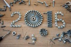 Szczęśliwy nowego roku 2016 skład z śrubami, gwoździ ryglami i dowels, Zdjęcia Stock