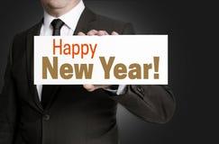 Szczęśliwy nowego roku znak trzymający biznesmena pojęciem Obraz Stock