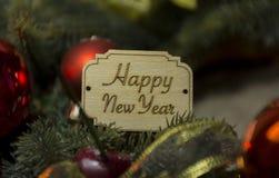 Szczęśliwy nowy rok i boże narodzenia, Bożenarodzeniowe wakacyjne dekoracje, yel Fotografia Royalty Free