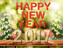 Szczęśliwy nowy rok 2017 liczb na Brown Drewnianym stołowym wierzchołku z abstraktem Obrazy Stock