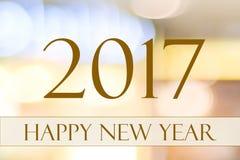 Szczęśliwy nowy rok 2017 na abstrakcjonistycznej plamy bokeh świątecznym tle Fotografia Royalty Free
