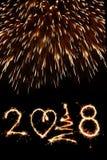 Szczęśliwy nowy rok 2018 pisać z fajerwerkami jako tło Obrazy Stock