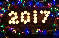 Szczęśliwy nowy rok 2017 pisać z płonącymi świeczkami Obraz Royalty Free