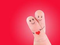 Szczęśliwy pary uściśnięcia pojęcie, malujący przy palcami Obraz Stock