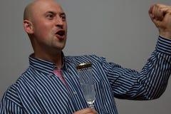 Szczęśliwy pijący biznesmen Fotografia Stock