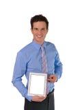 Szczęśliwy Pomyślny Młody biznesmen z pastylka komputerem osobistym Zdjęcia Stock
