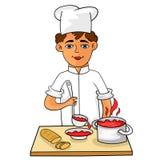Szczęśliwy potomstwo kucharz nalewa gorącą polewkę w pucharze Obrazy Stock