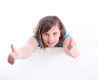 Szczęśliwy pozytywny dziewczyny przedstawienia kciuk up. zdjęcie royalty free
