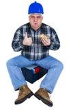 Szczęśliwy pracownik cieszy się jego hamburger Fotografia Royalty Free