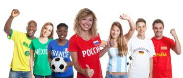 Szczęśliwy rosyjski piłka nożna zwolennik z fan od innych krajów fotografia royalty free