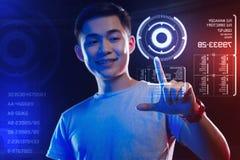 Szczęśliwy sieć przedsiębiorca budowlany dotyka round hologram na ono uśmiecha się i ekranie Zdjęcie Stock