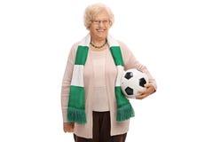 Szczęśliwy starszy piłki nożnej fan z szalikiem i futbolem obrazy royalty free