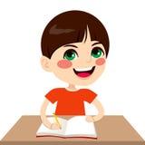Szczęśliwy Studencki chłopiec Writing Zdjęcia Stock