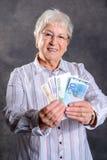 Szczęśliwy szary kosmaty kobieta pieniądze Zdjęcie Stock