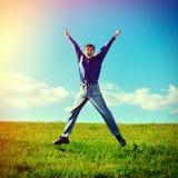 szczęśliwy tło nastolatków pojedynczy skokowy white Zdjęcia Stock