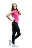 Szczęśliwy uśmiechnięty i energiczny dysponowany żeński sprawność fizyczna model zdjęcia stock