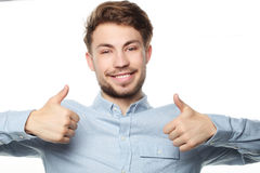 Szczęśliwy uśmiechnięty mężczyzna pokazuje kciukowi up ręka znaka na białym tle Obrazy Royalty Free