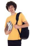 Szczęśliwy uczeń z plecakiem i książkami. Zdjęcie Stock