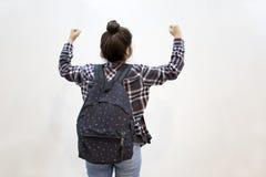 Szczęśliwy uczeń z rękami podnosić na powietrzu zdjęcie royalty free