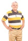 Szczęśliwy w średnim wieku dżentelmen patrzeje kamerę Obraz Stock
