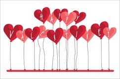 SZCZĘŚLIWY walentynka tekst NA serce KSZTAŁTUJĄCYCH balonach Fotografia Royalty Free