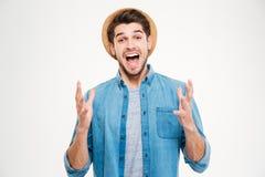 Szczęśliwy z podnieceniem młody człowiek odświętności sukces i krzyczeć Obraz Stock