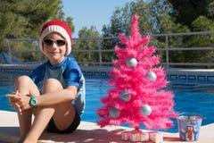 Szczęśliwych Świąt Bożego Narodzenia wakacje w ciepłych krajów pocztówkowym projekcie zdjęcia royalty free