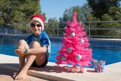 Szczęśliwych Świąt Bożego Narodzenia wakacje w ciepłych krajów pocztówkowym projekcie obrazy royalty free