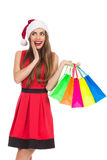 Szczęśliwych bożych narodzeń dziewczyna z torba na zakupy Fotografia Stock