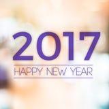 2017 Szczęśliwych nowy rok na abstrakcjonistycznym świątecznym plamy bokeh światła backgro Zdjęcie Stock