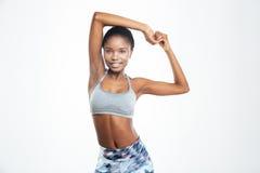 Szczęśliwych sportów kobiety rozciągania afro amerykańskie ręki Zdjęcie Royalty Free