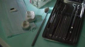 Szczęk narzędzia w stomatologicznej klinice i zęby zbiory