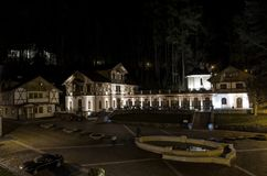 Szczawnica night photo. SZCZAWNICA, POLAND - April 25, 2017: vintage architecture illuminated in the evening in Szczawnica, Poland royalty free stock photos