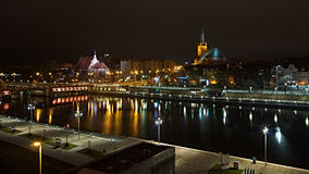 Szczecin at night. Szczecin at dark night. Lights on the river Stock Images