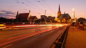 Szczecin after sunset. Urban lights illuminating the city center. View from the long bridge. Szczecin in Poland after sunset. Urban lights illuminating the city royalty free stock photos
